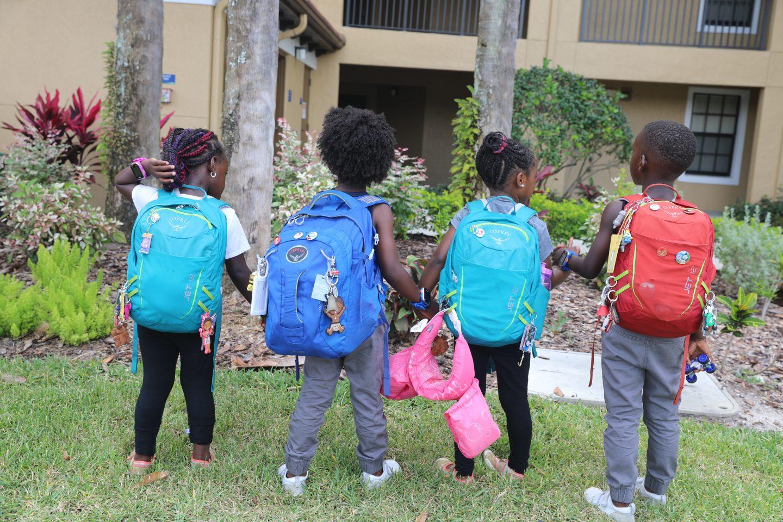 kids carrying osprey backpack